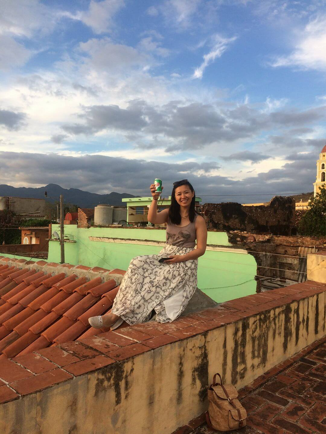 Sitting on a rooftop in Trinidad, Cuba, drinking Cristal and watching the sunset.