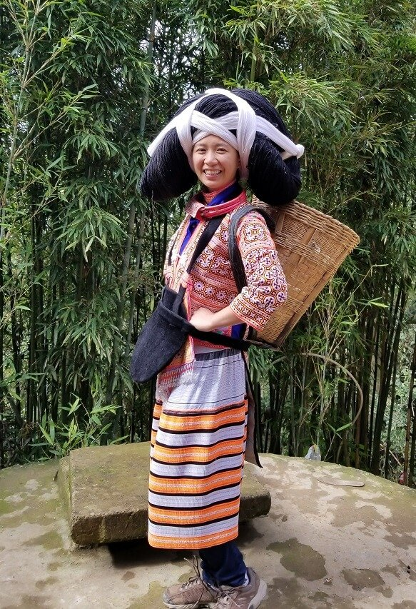 Longhorn Miao traditional costume with basket