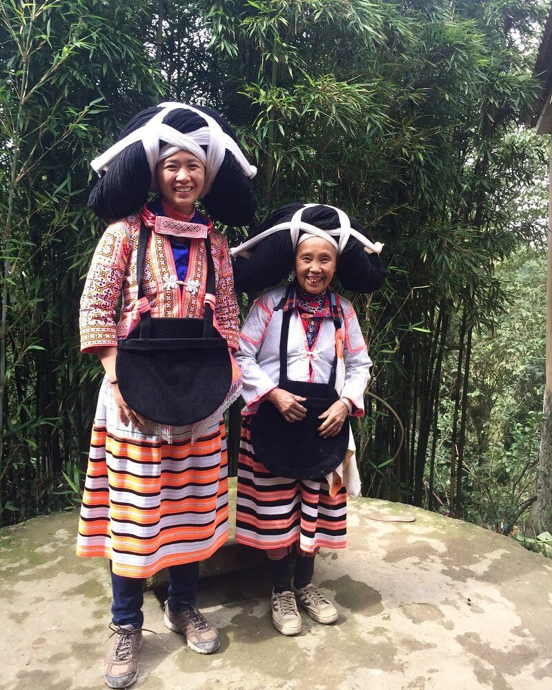 with Longhorn Miao woman