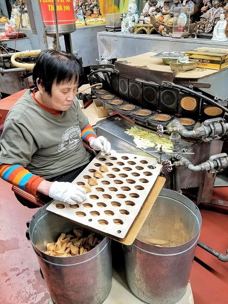worker at golden gate fortune cookie factory